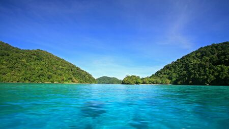 pristine corals: Crystal blue sea at snorkeling spot around Koh Surin in Phang Nga, Thailand  Stock Photo