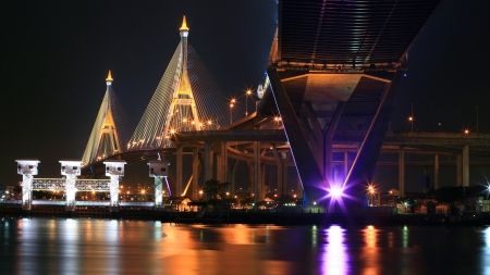 Industrial Ring Bridge, aka King Bhumibol, across Chao Phraya River at night in Bangkok, Thailand