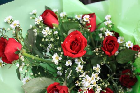 Red roses on green flower bouquet photo
