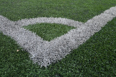 Corner of artificial grass soccer or football field photo