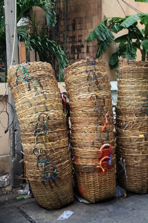 Stack of bamboo trash baskets photo