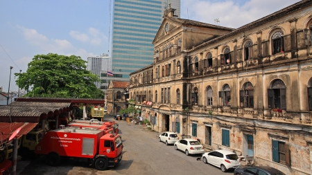 bangrak: BANGKOK-MAR 16  Antique Bangrak fire station with red fire trucks against blue sky on March 16, 2013 in Bangkok, Thailand  Bangrak fire station, founded in 1890, is still in operation until now