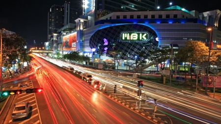 BANGKOK-MAR 16  Light trail on Phaya Thai road with MBK, one of the most famous shopping malls in Bangkok, at night on March 13,2013 in Bangkok,Thailand  Visitors can visit MBK by sky train and bus