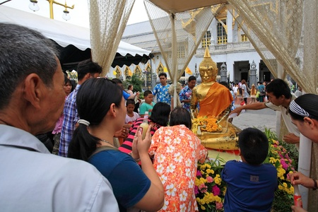 an obeisance: CHACHOENGSAO, THAILAND-APR 13  Unidentified people pour water to Buddha statue on Songkran, traditional Thai new year, day at Wat Sothon Wararam Worawihan on April 13, 2013 in Chachoengsao, Thailand  Editorial