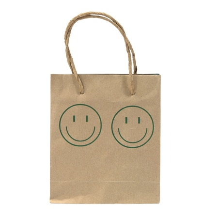 Small and old paper bag with green smile face isolated on white background  Stock Photo - 19318782