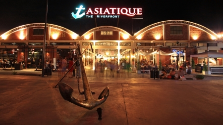 BANGKOK-JUL 07  Unidentified people visit Asiatique The Riverfront at night on July 07, 2012 in Bangkok, Thailand  Three are more than 500 outdoor shopping stores in Asiatique The Riverfront