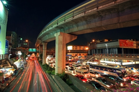 BANGKOK-APR 19  Elevated sky train railway above Phaholyothin road with light trails on April 19, 2013 in Bangkok, Thailand  Each skytrain can carry over 1,000 passengers through 32 stations     Editoriali