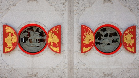 Chinese pattern on red wooden windows photo
