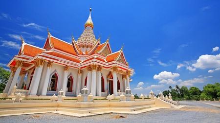 nakhon pathom: Beautiful Thai temple against blue sky at wat Thammasala in Nakhon Pathom, Thailand Stock Photo