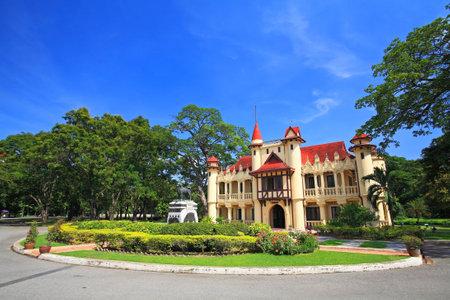 Chali Mongkol Asana,  European castle style of Sanam Chan Palace against blue sky in Nakhon pathom, Thailand