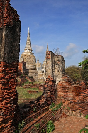 ayuttaya: Ancient structure with old pagodas against blue sky at Wat Phra Sri Sanphet in Ayutthaya, Thailand