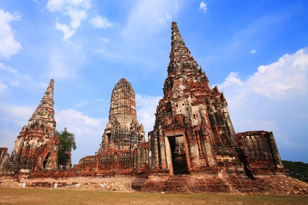 Wat Chaiwattanaram temple against blue sky in Ayutthaya Historical Park, Thailand photo