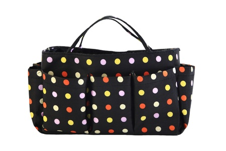 Handy bag with colorful spots isolated on white photo