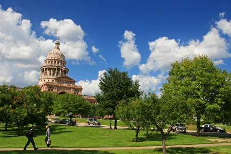 AUSTIN,TEXAS-JUL 19  Unidentified people walk at Texas state capitol in Austin, Texas on July 19, 2008  Capitol has 360,000 square ft  of floor space, more than any other state capitol building   Editoriali