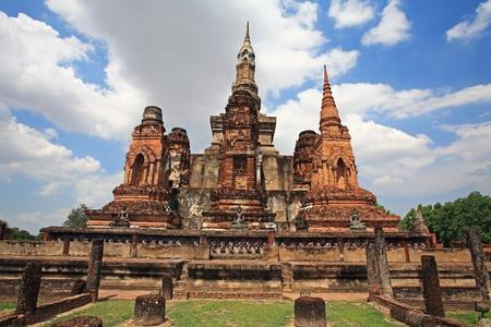 Ancient large pagodas against blue sky at Wat Mahathat in Sukhothai Historical park, Thailand photo