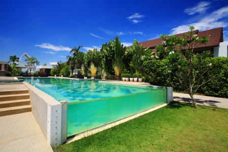 tourist resort: Luxury resort swimming pool against blue sky