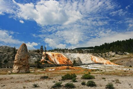 Monolith: Monolith at Mammoth Hot Springs against blue sky at Yellowstone national park in Wyoming, US  Stock Photo