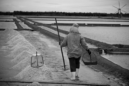 Worker on salt pan in Samut Sakhon, Thailand  photo