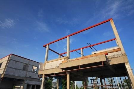 Modern houses under construction against blue sky photo