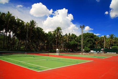 Outdoor tennis hard courts against blue sky photo