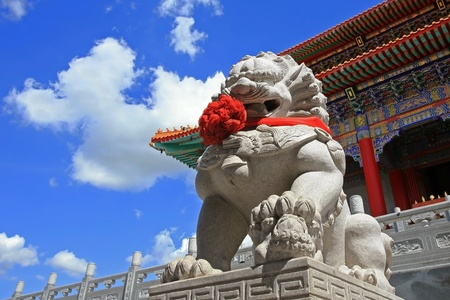 Chinese Lion statue against blue sky in Chinese Temple, wat leng nei yi, Thailand
