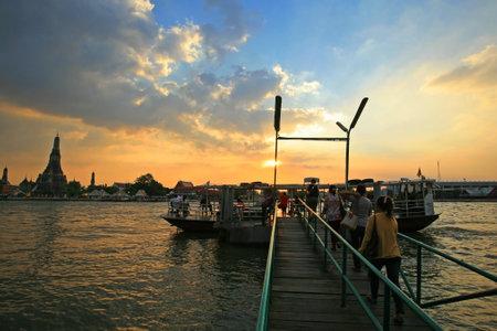 get across: BANGKOK-DEC 9 Unidentified people get into ferry to transit across Chao Phraya river to Wat Arun, Bangkok landmark found before 17th Century, at sunset sky on December 9, 2011 in Bangkok  Thailand