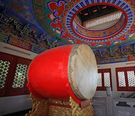 large red drum decorated inside Chinese temple for ceremonial purposes photo