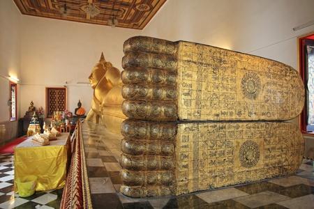 Large reclining Buddha statue inside Thai temple Stock Photo - 21597663
