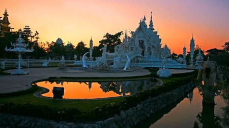 Wat Rong Khun at twilight sky in Chiang Rai, Thailand photo
