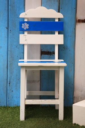 Small white and blue childrens chair, isolated on a white photo