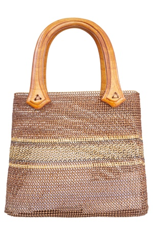Wicker handbag isolated on white background photo