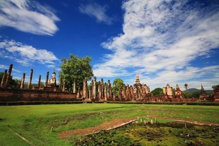 Sukhothai historical park - landscape of wat Mahathat against blue sky, Thailand photo