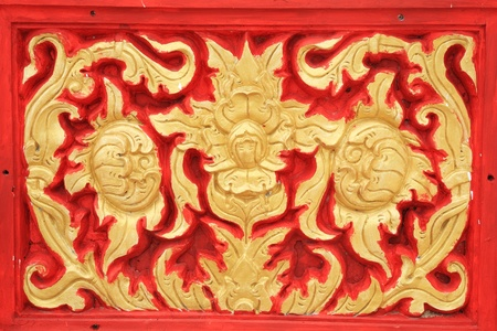 gold and red stucco design of thai floral pattern on the Wall photo