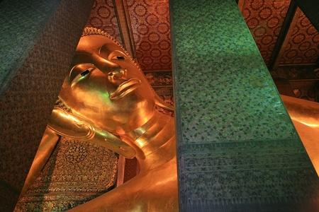 Reclining Buddha statue at the Wat Pho in Bangkok,Thailand Stock Photo - 21608565