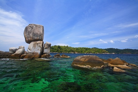 Stack rocky island against crystal Andaman sea at Koh Lipe, Thailand photo