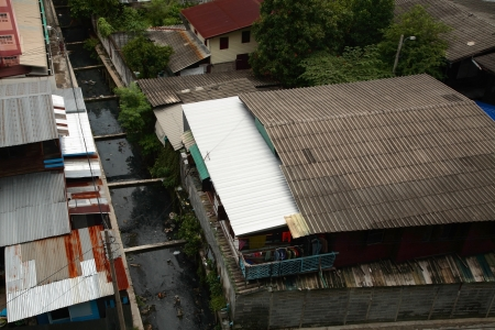 Aerial view of Slum near dirty canal in Bangkok, Thailand photo