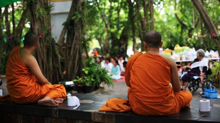 harity event: NONTHABURI-AUG 25: Unidentified Thai monks wait people to offer foods at Wat Chonprathan Rangsarit, found in 1957, on Aug 25, 2013 in Nonthaburi, Thailand. Editorial