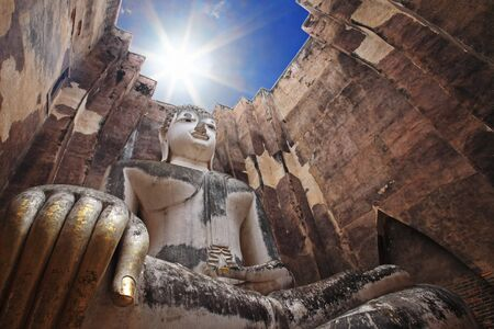 Big buddha against sunbeam at wat Srichum or Sri Chum. Sukhothai Province - Thailand photo