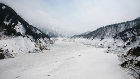 Kurobe alpine covering by snow at winter in Tateyama, Japan photo