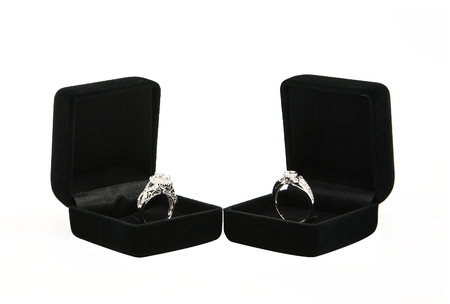 Couple wedding rings in black gift box isolated on white photo