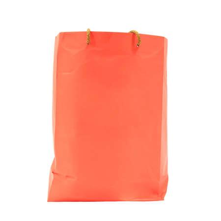 consummation: Orange paper shopping bag isolated on white Stock Photo