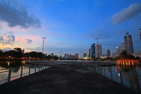 benjakitti: Benjakitti park against Bangkok modern buildings with Twilight sky Stock Photo
