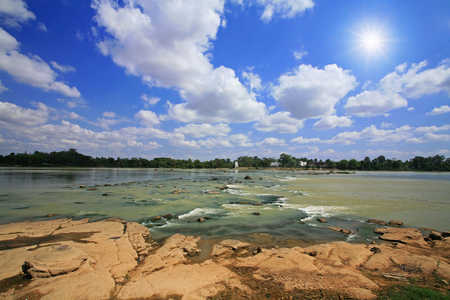 Mool river against sun beam and blue sky at Kang Sapue in Ubon Ratchathani province, Thailand photo