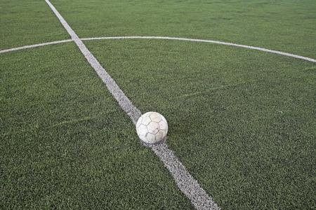 kickoff: Soccer ball at kickoff spot on fake soccer field Stock Photo