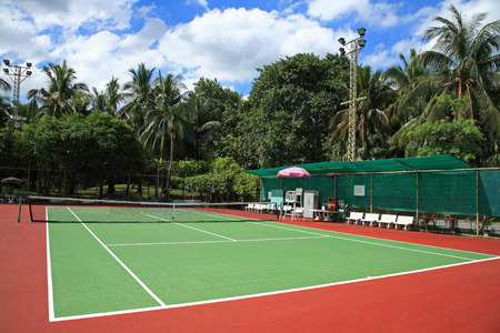 Outdoor tennis hard court against blue sky photo