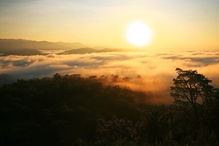 blue top: Aerial view of Sunrise over mountain and fog in Tak province, Thailand
