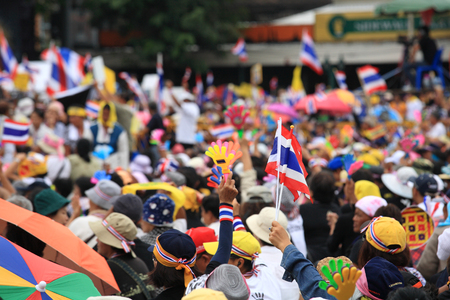 conservative: BANGKOK-NOV 24:  Unidentified Thai anti-government protesters raise fake clap hands and Thai flags to against government amnesty bill on Nov 24, 2013 in Bangkok, Thailand. Thai flag and fake clap hand are the sign of anti-government. Editorial