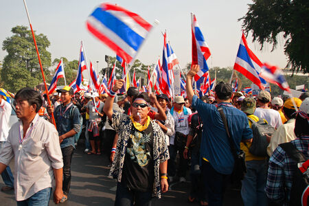 expel: BANGKOK-DEC 9: Unidentified protesters walk to Government House on December 09, 2013 in Bangkok, Thailand. Millions of Thai people rally from many streets to expel government today. Editorial