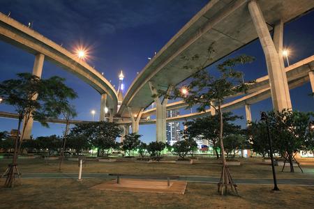 industrial park: Bhumibol Industrial circle bridge above a park at dusk in Bangkok, Thailand