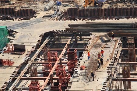 Workers at construction site making iron infrastructure